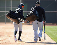 GLENDALE, ARIZONA - FEBRUARY 20:  Jon Jay #45 (L) and Yonder Alonso #17 of the Chicago White Sox walk toward a practice field during spring training workouts on February 20, 2019 at Camelback Ranch in Glendale Arizona.  (Photo by Ron Vesely). Subject:   Jon Jay; Yonder Alonso