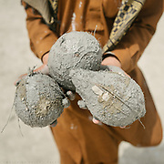 Three coconut caked in volcanic mud.