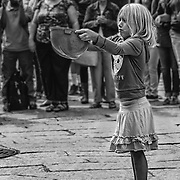 This shot outside Faneuil Hall in Boston, was taken just after its predecessor.  Brent McCoy (BrentMcCoy.com) was performing with this little girl as a volunteer assistant.  She was trying to catch the ball int he hard hat and just missed it.