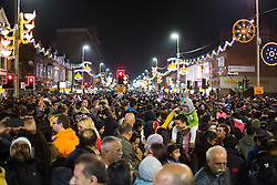 """© Licensed to London News Pictures. 01/11/2015. Leicester, UK. More than 35,000 people were estimated to have attended the annual Diwali ight switch-on which took place along the named """"Golden Mile"""" in Belgrave Road, Leicester. Pictured, the massive crowd watch as the lights come on. Photo credit : Dave Warren/LNP"""
