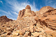 Sandstone towers rise above Lawrence's Spring in Wadi Rum, Jordan.