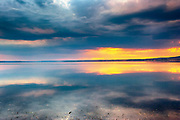 Reflections of the sunset in a calb lake