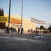 Dust from tear gas bombs and riot police in front of the parliament inSyntagma  (Constitution) square  during the the protests in Athens against the  unpopular austerity measures, June 29, 2011
