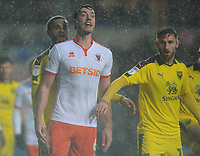 Blackpool's Ben Heneghan vies for possession with  Oxford United's Curtis Nelson and Josh Ruffels at a corner<br /> <br /> Photographer Kevin Barnes/CameraSport<br /> <br /> The EFL Sky Bet League One - Oxford United v Blackpool - Saturday 15th December 2018 - Kassam Stadium - Oxford<br /> <br /> World Copyright © 2018 CameraSport. All rights reserved. 43 Linden Ave. Countesthorpe. Leicester. England. LE8 5PG - Tel: +44 (0) 116 277 4147 - admin@camerasport.com - www.camerasport.com
