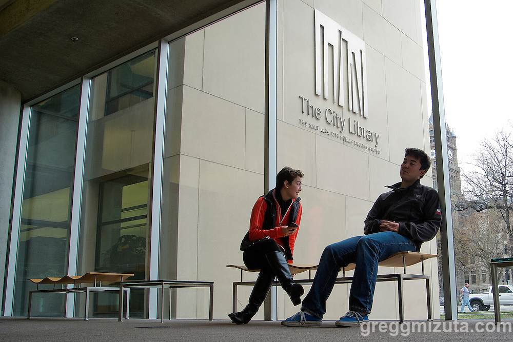 Megan and Brett Mizuta take a break at Salt Lake City's Main Library, 210 E 400 S, Salt Lake City, Utah, March 23- 27, <br /> <br /> Salt Lake City's Main Library, designed by internationally-acclaimed architect Moshe Safdie, embodies the idea that a library is more than a repository of books and computers; it reflects and engages the city's imagination and aspirations.