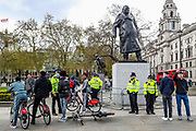 Police are deployed around Winston Churchill monument during a demonstration against the Policing and Crime Bill in central London on Saturday, May 1, 2021. The Bill is currently making its way through Parliament. The Government claims the legislation is needed to stop disruptive protests but critics claim it undermines free expression. (Photo/ Vudi Xhymshiti)