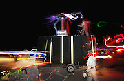 At Burning Man, PhD tech nerd and artist Austin Richards demonstrates the power of his Tesla coil, which he has named Megavolt. Richards is protected from the electrical strikes by a special suit. Burning Man is a performance art festival known for art, drugs and sex. It takes place annually in the Black Rock Desert near Gerlach, Nevada, USA.