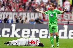 06.08.2011,  Rhein Energie Stadion, Koeln, GER, 1.FBL, 1. FC Koeln vs Vfl Wolfsburg, im Bild.Christian Eichner (Koeln #4) liegt verletzt am Boden. Patrick Ochs (Wolfsburg #2) hat nix gemacht..// during the 1.FBL, 1. FC Koeln vs Vfl Wolfsburg on 2011/08/06, Rhein-Energie Stadion, Köln, Germany. EXPA Pictures © 2011, PhotoCredit: EXPA/ nph/  Mueller *** Local Caption ***       ****** out of GER / CRO  / BEL ******