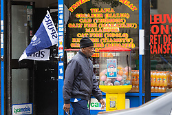 A Spurs flag flutters in the breeze in the doorway of a shop in Tottenham ahead of Spur's Champions League final with Liverpool to be played at Atletico Madrid's Wanda Metropolitano Stadium in Madrid. Tottenham, London, May 29 2019.