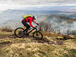 Man riding electric mountain bike on cycling tour, Vosges, France