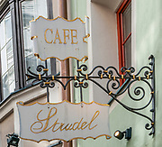 Coffee and Strudel shop sign in Hofgasse Street Innsbruck, Austria