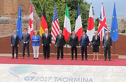 May 26, 2017 - Taormina, Italy - (From L to R) European Council President Donald Tusk, Canadian Prime Minister Justin Trudeau, German Chancellor Angela Merkel, U.S. President Donald Trump, Italian Prime Minister Paolo Gentiloni, French President Emmanuel Macron, Japanese Prime Minister Shinzo Abe, British Prime Minister Theresa May and European Commission President Jean-Claude Juncker pose for the group photo at the G7 Taormina summit on the island of Sicily on May 26, 2017 in Taormina, Italy. Leaders of the G7 group of nations, which includes the Unted States, Canada, Japan, the United Kingdom, Germany, France and Italy, as well as the European Union, are meeting at Taormina from May 26-27. (Credit Image: © Gabriele Maricchiolo/NurPhoto via ZUMA Press)