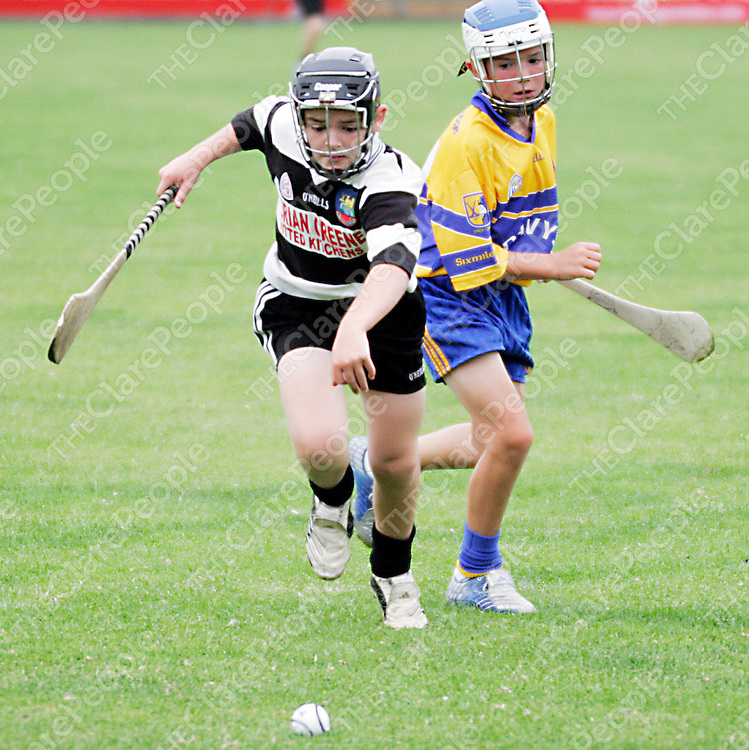 Clarecastle's Dillon Broderick and Sixmilebridge's Alex Morey race for a loose ball during their U-12 A hurling final in Cusack Park on Friday evening.<br /><br /><br /><br />Photograph by Yvonne Vaughan.