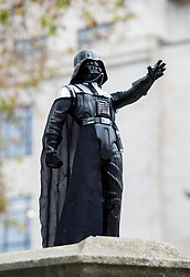 © Licensed to London News Pictures; 02/12/2020; Bristol, UK. People view and photograph a new statue of Darth Vader which has been placed on the plinth where the statue of Edward Colston used to stand before it was pulled down and thrown into Bristol docks on 07 June 2020. The Darth Vader statue's appearance follows the recent death on 29 November of actor Dave Prowse who came from Bristol and played the character of Darth Vader in the first three Star Wars films. Since the Colston statue was pulled down various other statues and artworks have been placed on the empty plinth without permission from Bristol City council. Photo credit: Simon Chapman/LNP.
