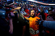 Johny Hendricks celebrates after defeating Robbie Lawler for the UFC Welterweight Championship during UFC 171 at the American Airlines Center in Dallas, Texas on March 15, 2014.
