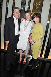 Left to right, JOHN HURT, SVETLANA K-LIE and ANWEN REES MEYERS at W London - Leicester Square for the Liberatum Cultural Honour in Spice Market for John Hurt, CBE in association with artist Svetlana K-Lié on 10th April 2013.