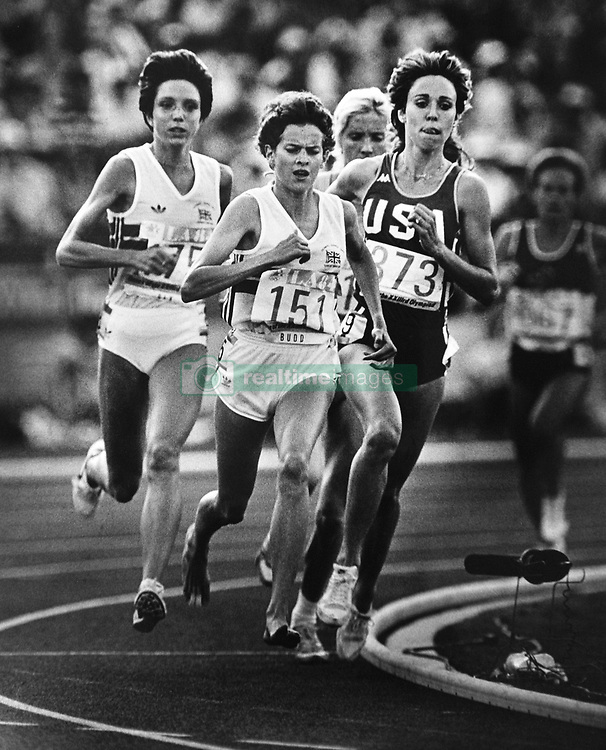 Aug 10, 1984 - Los Angeles, California, U.S. - American 3000 meter competitor MARY DECKER, right, runs on the inside of the track slightly behind  British (South African) runner ZOLA BUDD in the 1984 Olympics. This was just after 1,600 meters had been run, on the turn into the front straightaway. The two were set up for a famous race, the American darling Decker trying to win an Olympic Gold medal after years of difficulties and disappointments versus the controversial Zola Budd, a barefoot-running teenager who grew up in South Africa and bent the Olympic rules to compete for Britain, because South Africa was banned from the games due to their apartheid policy. When the two tangled coming out of a corner on the track, Decker fell onto the infield, injuring her hip unable to finish the race. The crowd expressed their anger by booing Budd, who continued on to finish seventh. Budd later claimed to have thrown the race in order to avoid further booing from the crowd had she won. The incident is regarded as one of the biggest upsets in Olympics history. (Credit Image: © Bruce Chambers/ZUMA Wire/ZUMAPRESS.com)