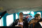 Ecuador, May 5 2010: Lorna Brooks and Jorge in airplane flying into Huaorani territory. Copyright 2010 Peter Horrell