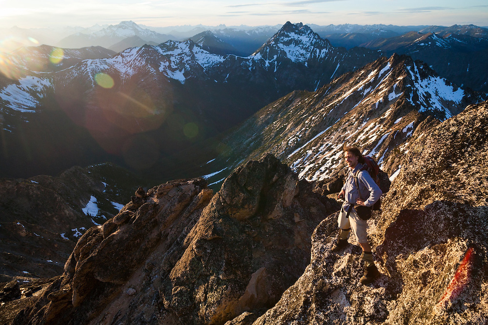Kevin Steffa looks out to the surrounding peaks from the summit of Golden Horn, Okanogan National Forest, Washington.