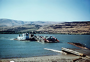 """CS00934-02. """"Crossing Columbia River near The Dalles"""" ferry J. B. Switzler, 1949. (The Maryhill ferry across the Columbia River, to Biggs, Oregon. The ferry is the J. B. Switzler, a 36 foot tug built for William Switzler, operator of the ferry, by Gunderson in 1941. This was the first ship Gunderson ever built. The ferry operated until November 1, 1962, when it was replaced by Sam Hill Memorial Bridge.)"""