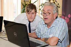 Digital Region Co-Running a series of workshops to equip the elderly with basic computer skills at Bakersfield Court sheltered housing on Longfellow Drive Rotherham Scott Castle with Ron Roberts..21 March 2011.Images © Paul David Drabble