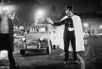 French police, gendarmes, near the Arc de Triomphe on the Champs Elysees, Paris, New Year's Eve, 1973-74 - Photograph by Owen Franken - Photograph by Owen Franken