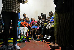 JOHANNESBURG, SOUTH AFRICA - APRIL 14: Children and community residents in a room during a visit by Johannesburg Mayor, Geoffrey Makhubo. The mayor visited Alexandra to address community concerns from the effects of the national lockdown on April 14, 2020 in Johannesburg South Africa. Under pressure from a global pandemic. President Ramaphosa declared a 21 day national lockdown extended by another two weeks, mobilising goverment structures accross the nation to combat the rapidly spreading COVID-19 virus - the lockdown requires businesses to close and the public to stay at home during this period, unless part of approved essential services. (Photo by Dino Lloyd)