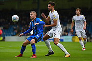 Gillingham FC midfielder Dean Parrett (8) and Peterborough United defender Ryan Tafazolli (5) during the EFL Sky Bet League 1 match between Gillingham and Peterborough United at the MEMS Priestfield Stadium, Gillingham, England on 22 September 2018. Picture by Martin Cole