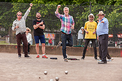 """© Licensed to London News Pictures. 05/06/2015.   London, UK. Media and guests taking part in """"Freddie for the Day"""", some dressing up as Queen's lead singer, Freddie Mercury, by playing a special game of celebrity Pétanque, competing for the Londonaise 'Celebrity Pétanque Trophy', ahead of The Londonaise Pétanque festival this weekend in Barnard Park, Islington.  The festival will set a new precedent in the UK with 128 teams taking part in the main tournament.  The event also aims to raise funds for the Mercury Phoenix Trust to fight against AIDS worldwide. Photo credit : Stephen Chung/LNP"""