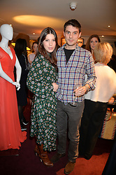 LILY LEWIS and JASON DE SAVARY at a party hosted by Lady Kinvara Balfour, Lavinia Brennan and Lady Natasha Rufus Isaacs to celebrate the Beulah French Sole Collaboration in aid of the UN Blue Heart Campaign, held at George, 87-88 Mount Street, London on 10th December 2013.