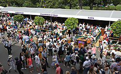 People queuing for food and drinks on day one of the Wimbledon Championships at the All England Lawn Tennis and Croquet Club, London.