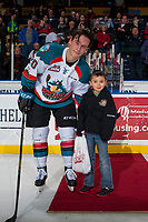 KELOWNA, CANADA - JANUARY 3: Conner Bruggen-Cate #20 of the Kelowna Rockets stands with a young fan after earning the third star of the game against the Tri-City Americans on January 3, 2017 at Prospera Place in Kelowna, British Columbia, Canada.  (Photo by Marissa Baecker/Shoot the Breeze)  *** Local Caption ***