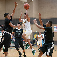 In Newcomb, Douglas Whitehorse (34) of Tse Yi Gai tries to defend the shot as Deion Johnhat (2) of Newcomb shoots on the drive in the paint. Newcomb won 83-49 on Saturday.