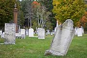 Headstones in cemetery in Fall.