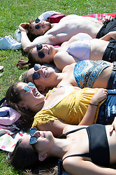 © Licensed to London News Pictures 18/07/2021. Greenwich, UK. Friends enjoying the heat in Greenwich Park, London as the hot heatwave weather continues today with temperatures expected to hit 30C. Photo credit:Grant Falvey/LNP