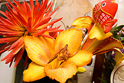 Artificial flower arrangement in yellow and red. St Paul Minnesota MN USA
