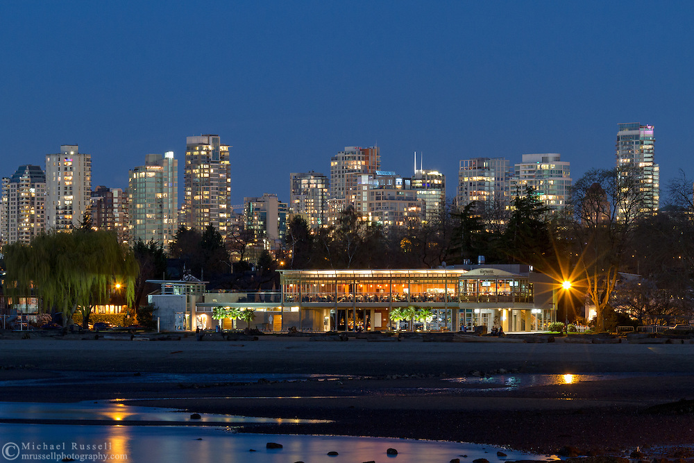 Kitsilano Beach, Vancouver condo towers, and the Boathouse Restaurant in the early evening. Photographed from Kitsilano Beach Park in Vancouver, British Columbia, Canada