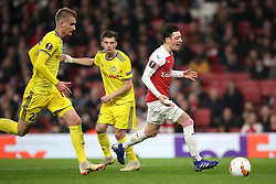 Arsenal's Mesut Ozil (right) appears dejected after failing to collect the ball during the UEFA Europa League round of 32 second leg match at the Emirates Stadium, London.