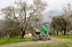 Two Mountainbikers racing through olive grove