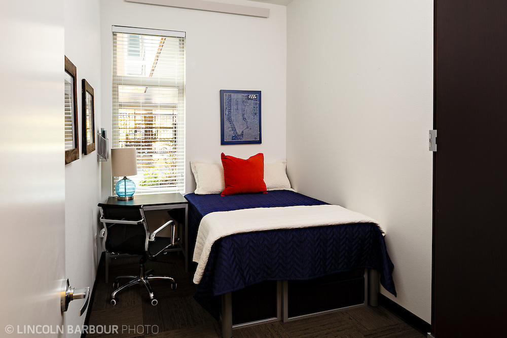 University House student housing apartment in Eugene, OR. Designed by Mahlum Architects. A very small bedroom with just enough room for a bed and a desk