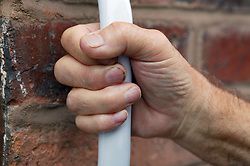 Close up of a grab rail attached to a wall,