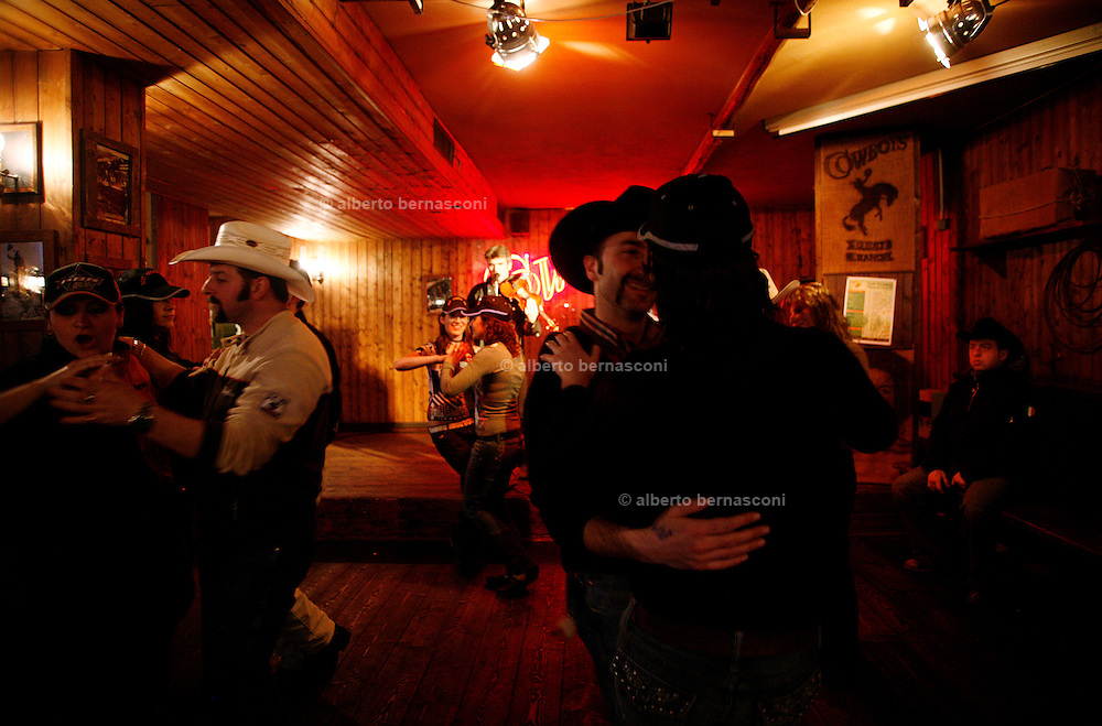 Italy, Voghera, Cowboys ranch: the saloon, practising the  characteristic cowboy dance  .Cowboys show and contest.