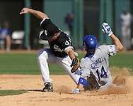 GLENDALE, AZ - MARCH 5:  Jamey Carroll #14 of the Los Angeles Dodgers steals second base as Brent Lillibridge #18 of the Chicago White Sox cannot handle the ball on March 5, 2010 at The Ballpark at Camelback Ranch in Glendale, Arizona. (Photo by Ron Vesely)