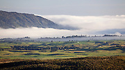 Overlooking a foggy landscape from the village of Whakapapa, in Tongariro National Park, New Zealand.