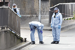 © Licensed to London News Pictures. 24/05/2021. London, UK. Forensics officers conduct a search at Consort Road in Peckham south London after Black Lives activist Sasha Johnson was shot. Ms Johnson remains in a critical condition in hospital after the shooting which happened at 3am on Sunday morning. Photo credit: Peter Macdiarmid/LNP