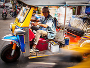 19 DECEMBER 2013 - BANGKOK, THAILAND:   A tuk-tuk or three wheeled taxi speeds through traffic in the Chinatown section of Bangkok.      PHOTO BY JACK KURTZ