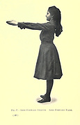 Arms forward stretch. Arms forward raise from the book ' Gymnastic exercises for elementary schools, supplemented by fancy steps and games ' Trask, Harriet Edna, Published in 1904 in Philadelphia by Christopher Sower Company