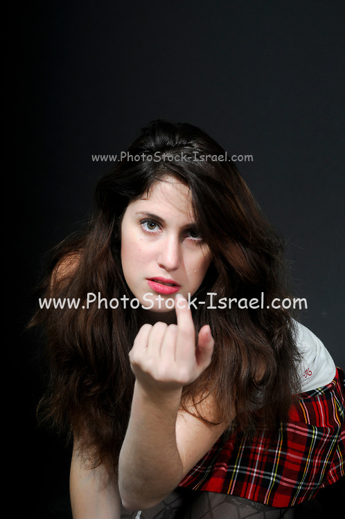 Young woman (25 to 29) uses finger to lure and tempt the viewer