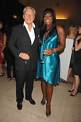 MICA PARIS and PER NEUMAN Managing Director of Estee Lauder at the M.A.C. Viva Glam party featuring a performance by Dita Von Teese of 'Lipteese' held at the Bloomsbury Ballroom, Victoria House, Bloomsbury Square, London on 27th June 2007.<br />