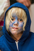 A young boy attempts to mimic one of the X-men by painting his face blue - The 'global fan screening' of Twentieth Century Fox's X-Men Apocalypse at the BFI IMAX at Waterloo.